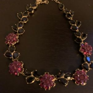 Burgundy jeweled necklace.